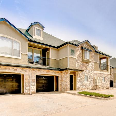View of Building Exterior, Showing Balconies and Attached Garages at Stonebriar of Frisco Apartments