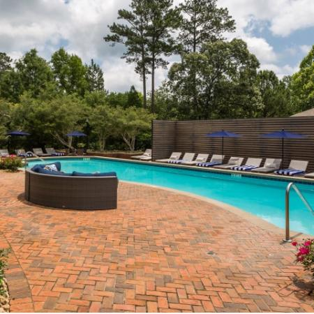 Image of Retreat at Peachtree City's pool, sundeck, outdoor furniture and poolside lounge chairs