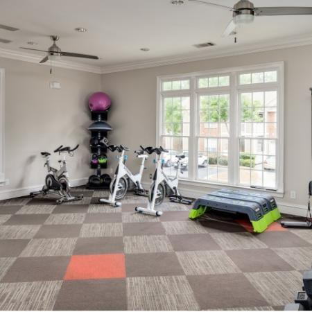 Image of fitness center at Retreat at Peachtree City with stationary bikes, free weights, and cable machine