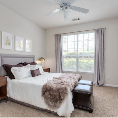 Image of apartment bedroom with bed and nightstands at Retreat at Peachtree City