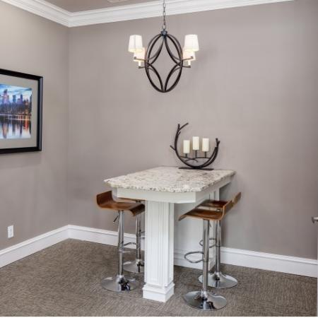 Image of meeting space at Retreat at Peachtree City with a granite counter and counter stools