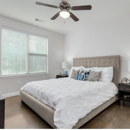 View of Bedroom, Showing Ceiling Fan and Window View at The Melrose Apartments