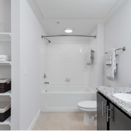 View of Bathroom, Showing Single Vanity, Granite Countertop, and Built-In Shelves at The Melrose Apartments