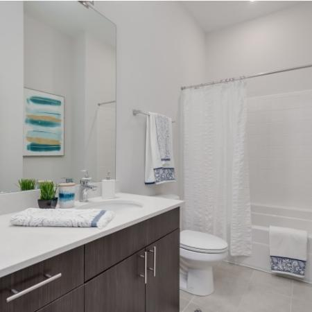 View of Bathroom, Showing Single Vanity, Toilet, and Tub at The Melrose Apartments