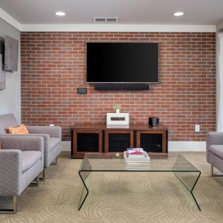 View of Media Lounge, Showing Seating Area and TV at Cottonwood Westside Apartments