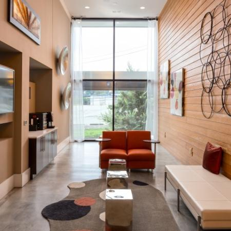 View of Resident Lounge, Showing WiFi Café, Seating Areas, TV, and Window View at Cottonwood Westside Apartments