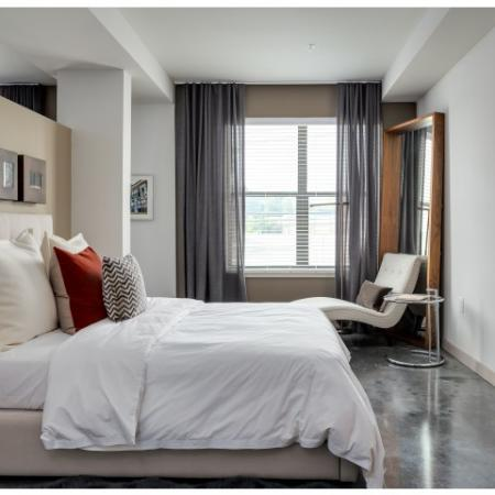 View of Bedroom, Showing Furnished, Accent Chair, and View of Window at Cottonwood Westside Apartments