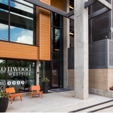 View of Leasing Office, Showing Entrance and Outdoor Furniture at Cottonwood Westside Apartments