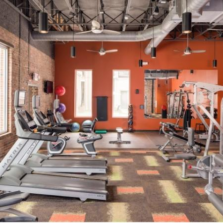 View of Fitness Center, Showing Cardio Machines, Cable Machines, and Exercise Balls at The Melrose Apartments