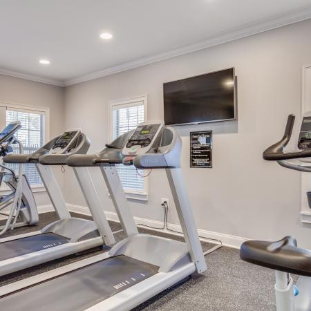 View of Fitness Center, Showing Cardio Machines, TV, and Window View at Arbors at Fairview Apartments