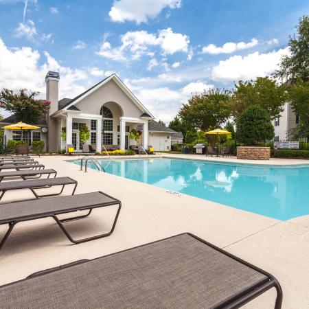 View of Pool Area, Showing Loungers, Grill, Umbrellas, and Chairs, Tables at Arbors at Fairview Apartments