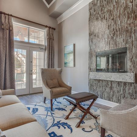 View of Resident Lounge, Showing Sitting Area, Fireplace, and Window View at Arbors at Fairview Apartments