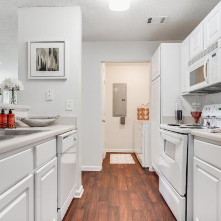 View of Classic Apartment Interior, Showing Kitchen With Plank-Wood Flooring and  Gas  Appliances at Arbors at Fairview Apartments