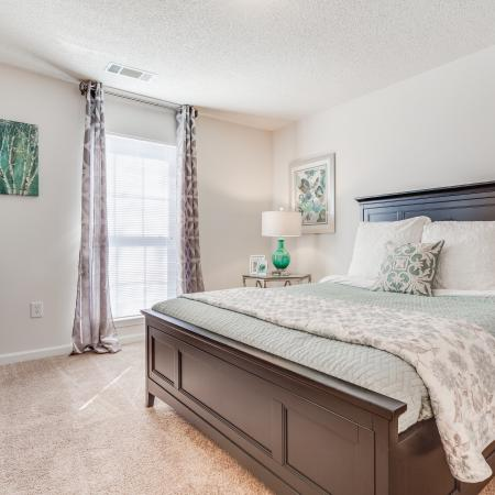 View of Classic Apartment Interior, Showing Furnished Bedroom With Layered Bedding and Window View at Arbors at Fairview Apartments