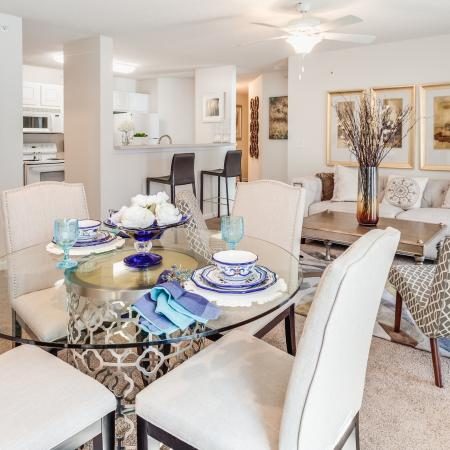 View of Classic Apartment Interior, Showing Dining Area With Dining Table, View of Living Room, and Kitchen at Arbors at Fairview Apartments