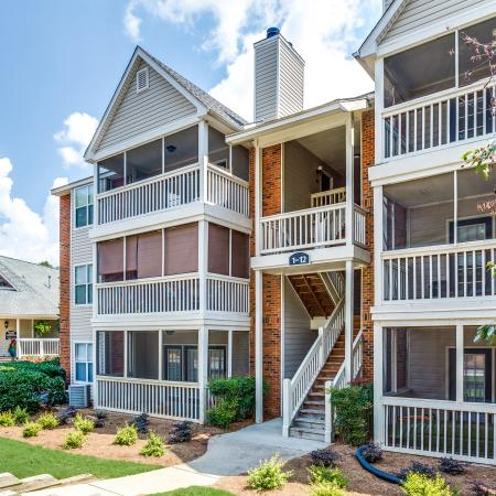View of Building Exterior, Showing Landscaping, Patios, and Balconies at Plantations at Haywood Apartments