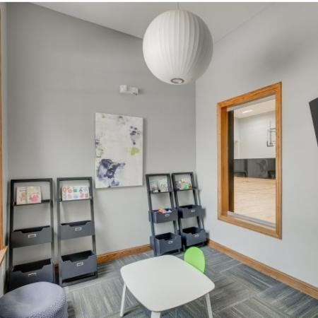 Image of childrens activity room with window into the indoor sport courts