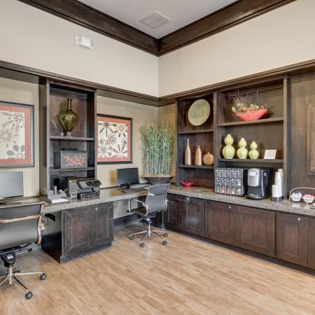 View of Business Center, Showing Desk With Two Monitors, Décor, Plank Flooring and Coffee Bar at Retreat at Stafford Apartments