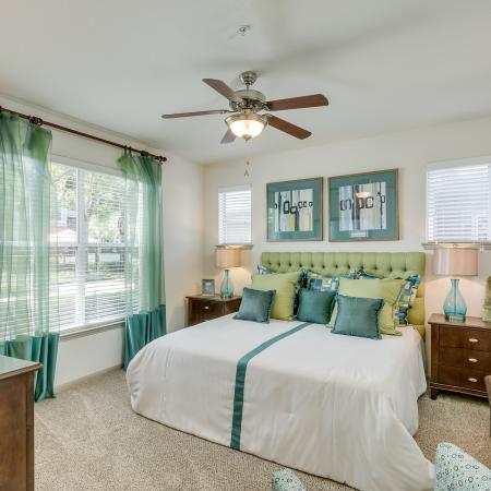 View of Furnished Bedroom, Showing Carpet, Windows, and Ceiling Fan at Retreat at Stafford Apartments