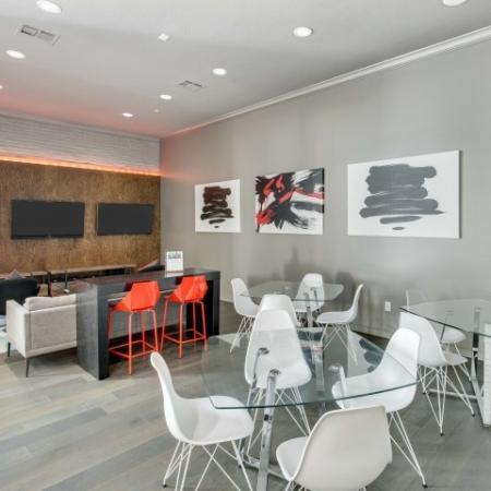 Image of Social Area with couch, chairs, tables and counter stool and 3 flat screen tvs