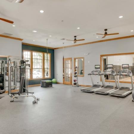 Image of fitness center with 3 treadmills, free weight station, an elliptical machine