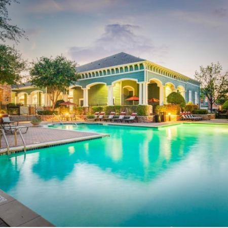 Image of Cottonwood Ridgeview's pool, poolside lounge chairs, and building exteriors