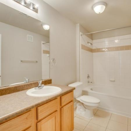 Image of classic style apartment bathroom with vanity, single sink, and garden style bathtub