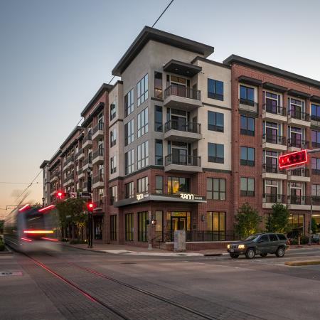 View of Building Exterior, Showing Street View of Apartment Structure and Metro at 3800 Main Apartments