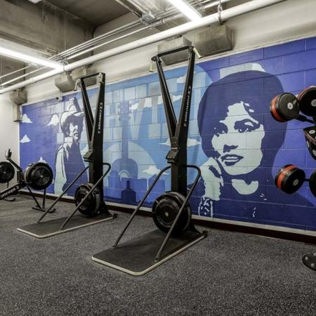 View of Fitness Center, Showing Punching Pads, Rowing Machines, Cardio Machines at The Melrose Apartments