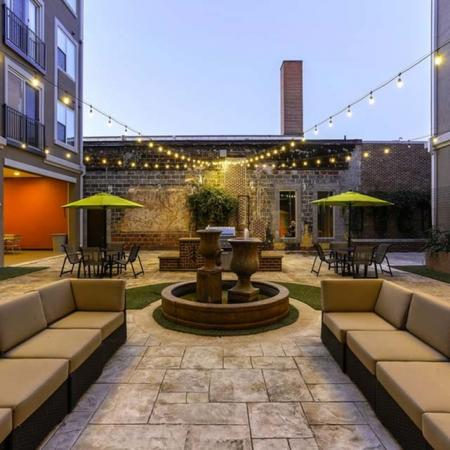 View of Outdoor Lounge, Showing Outdoor Furniture, Fountain, and Picnic Areas at The Melrose Apartments