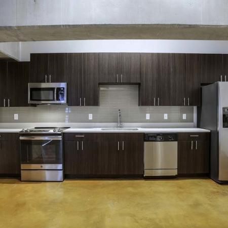 View of Kitchen, Showing Stainless Steel Appliances and Granite Countertop  at The Melrose Apartments