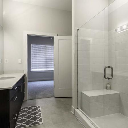 View of Bathroom, Showing Plank Wood Flooring and Walk-In Shower at The Melrose Apartments
