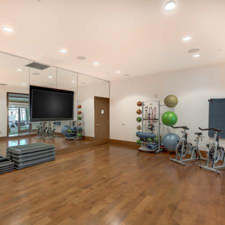 Image of spin studio with stationary bikes, exercise ballas, and a flat screen tv at The Marq