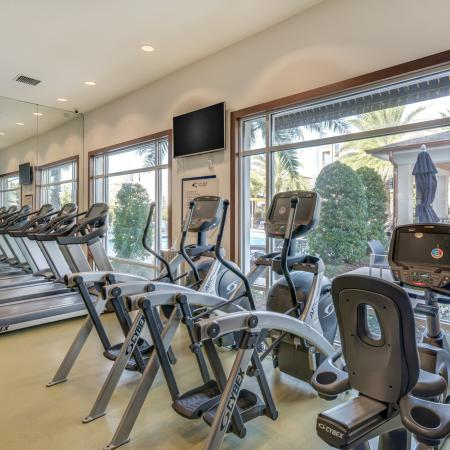 Image of cardio machines and flat screen tvs at The Marq's fitness center