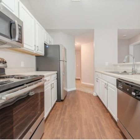 View of Renovated Apartment Interior, Showing Kitchen With Galley Style and Stainless Steel Appliances at Arbors at Fairview Apartments