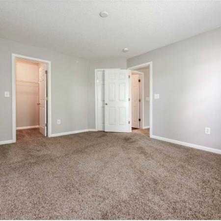 View of Renovated Apartment Interior, Showing Bedroom With Modern Paint and View of Closet at Arbors at Fairview Apartments