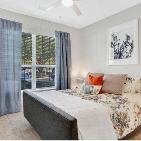 View of Bedroom, Showing Furnished Bed, Décor, Window, and Carpet at Retreat at River Park Apartments