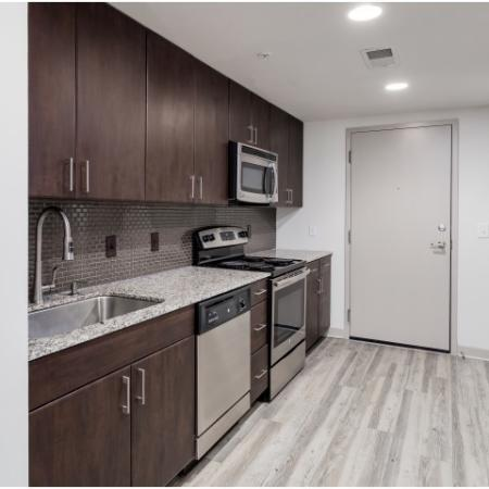View of Kitchen, Showing Granite Countertop and Stainless Steel Appliances at Cottonwood Westside Apartments