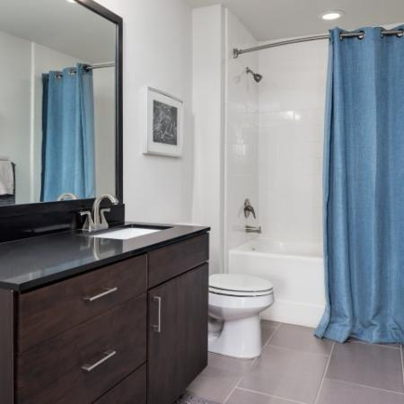 View of Bathroom, Showing Single Vanity, Toilet, and Tub at Cottonwood Westside Apartments