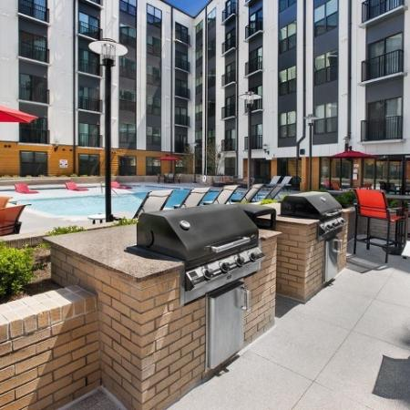 View of Grilling Lounge, Showing Grills, Picnic Areas and Adjacent to Pool at Cottonwood Westside Apartments