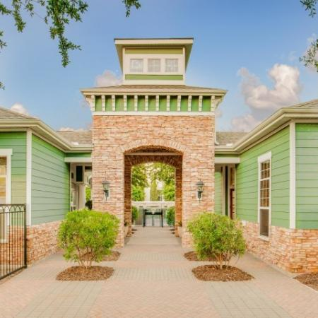 Image of Cottonwood Ridgeview Leasing Office Entrance with teal siding and brick accents