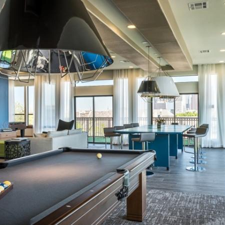 View of Resident Lounge, Showing Pool Table, Seating Areas, and TV at 3800 Main Apartments