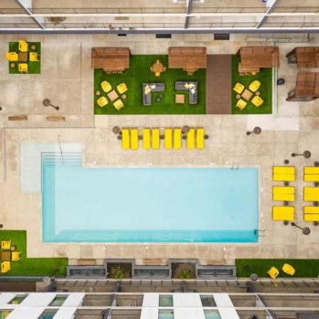 View of Pool Area, Showing Aerial View of Pool, Loungers, Cabanas, Pergolas, and Sitting Areas at 935M Apartments