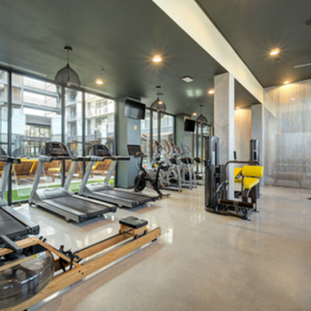 Private health club with treadmills, ellipticals, and rowing machine