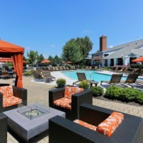 Image of Cason Estates pool, lounge chairs, cabanas, outdoor furniture and community exterior