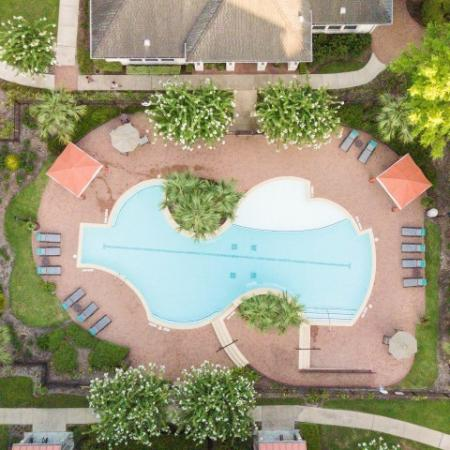 View of Resort Style Pool, Showing Aerial Overview, Sundeck, Pavilions and Greenspace at Retreat at Stafford Apartments