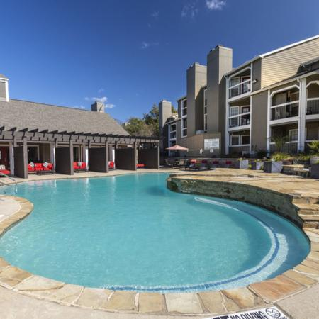 View of Pool Area, Showing Loungers, Landscaping, and Pergola at The Arbors of Las Colinas Apartments