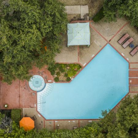 View of Resort Style Pool, Showing Aerial of Loungers, Cabanas, and Water Feature at Spring Pointe Apartments