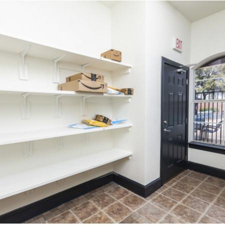 View of Package Room, Showing Area With Shelving and Door for Resident Package Pickup at Bluffs at Vista Ridge Apartments