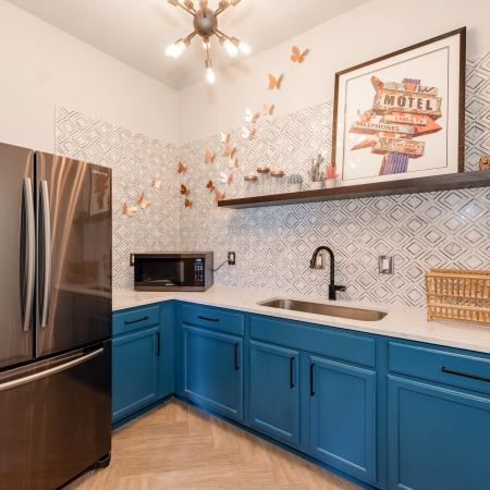 View of Community Kitchen, Showing Fridge, Microwave, Sink, Cabinets, Countertop and Décor at Waterford Creek Apartments